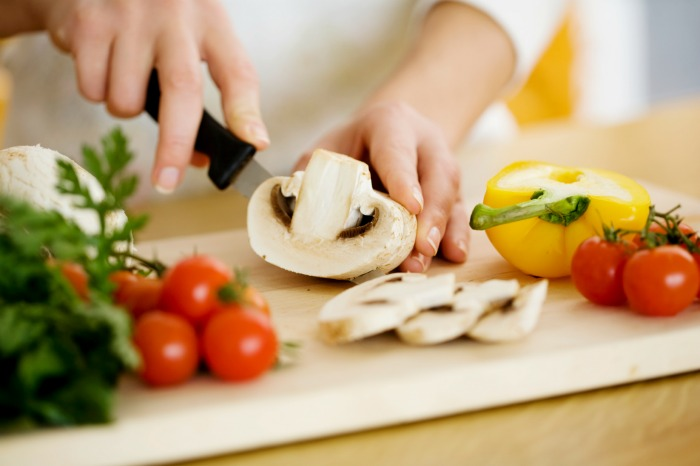female chopping food ingredients - HealthWorks Malaysia